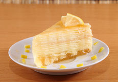 Lemon crepe cake with honey on plate. Stock Images