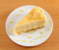 Lemon crepe cake with honey on plate. Royalty Free Stock Photography