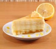 Lemon crepe cake with honey on plate. Stock Image