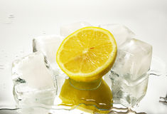 Lemon and cristal cube of ice Royalty Free Stock Image