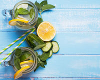Lemon and cucucmber detox water in glass jars Royalty Free Stock Photo
