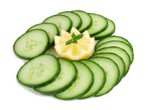 Lemon and cucumber. Isolated slices of  lemon and cucumber  on a white background Royalty Free Stock Photo