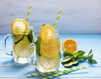 Lemon and cucumber detox water in glass jars Royalty Free Stock Photo