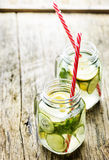 Lemon and cucumber drink in retro jars Royalty Free Stock Images