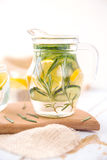 Lemon Cucumber and Rosemary Detox Water. On wooden table Royalty Free Stock Photography