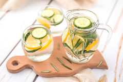 Lemon Cucumber and Rosemary Detox Water. On wooden table Royalty Free Stock Photos