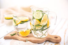 Lemon Cucumber and Rosemary Detox Water. On wooden table Stock Image