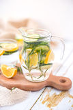 Lemon Cucumber and Rosemary Detox Water on wooden table. Lemon Cucumber and Rosemary Detox Water Royalty Free Stock Images