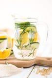 Lemon Cucumber and Rosemary Detox Water on wooden table. Lemon Cucumber and Rosemary Detox Water Stock Photos