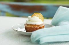 Lemon cupcake with blue mint napkin Royalty Free Stock Image
