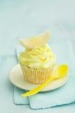 Lemon cupcake. Decorated with a slice of lemon Royalty Free Stock Photos