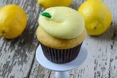 Lemon Cupcake. With Fresh Lemons on a Cupcake Stand Stock Photo