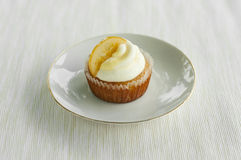 Lemon cupcake on the white plate Royalty Free Stock Image