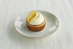 Lemon cupcake on the white plate. Image of single lemon cupcake on the white plate, shot in the nature Royalty Free Stock Image
