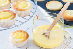 Lemon cupcakes preparation and ingredients Stock Photo