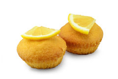 Lemon cupcakes. Two cupcakes with lemon aroma, isolated on white background royalty free stock image