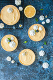 Lemon curd and blueberry jam tarts with meringue Stock Photo