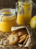 Lemon curd with cookies Stock Images