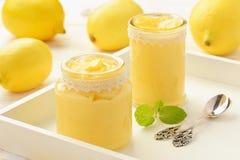 Lemon curd english citrus cream in glass jars. Royalty Free Stock Photography