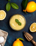 Lemon curd in a glass bowl Stock Photography