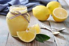 Lemon curd in glass jar Royalty Free Stock Photos