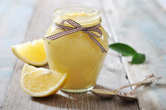 Lemon curd in glass jar Royalty Free Stock Image
