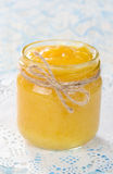 Lemon curd. Homemade lemon curd in glass jar Royalty Free Stock Photography