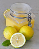 Lemon curd and lemons Stock Photos