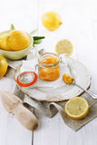Lemon curd over white wooden background Royalty Free Stock Image