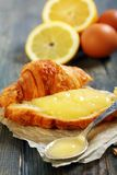 Lemon curd on a slice of fresh croissant. Stock Photos