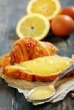 Lemon curd on a slice of fresh croissant. Stock Photos