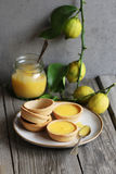 Lemon curd tarts and baked pastry on a plate Stock Photos