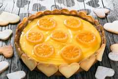 Lemon custard tart, decorated with biscuits, top view, close-up Stock Photos