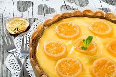Lemon custard tart, decorated with biscuits, top view, close-up Stock Photo