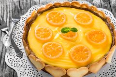 Lemon custard tart, decorated with biscuits, top view, close-up Stock Photography