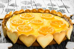 Lemon custard tart, decorated with biscuits, top view, close-up Royalty Free Stock Image