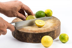Lemon cut on chopping board Royalty Free Stock Photo