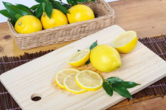 A lemon cut in clean environment Royalty Free Stock Photos