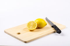 Lemon. Cut with kitchen knife isolated in white Royalty Free Stock Images