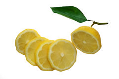 Lemon cut in slices with leaf. Stock Photos