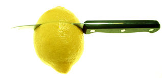 Lemon, cutting, problem solution. Knife cutting bitter lemon, bitter business or cutting a problem i half. cooking or drink cocktail ingredients Royalty Free Stock Image