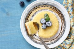 Lemon delicious pudding cake  served with berries Royalty Free Stock Images