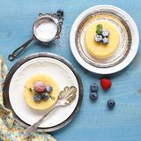 Lemon delicious pudding cake  served with berries Royalty Free Stock Image