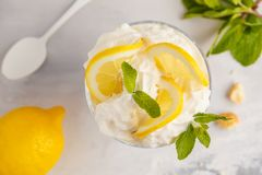 Lemon dessert. English lemon trifle, cheesecake, whipped cream,. Lemon dessert, lemon trifle, cheesecake, whipped cream, parfait. Fruit mousse in glass on a royalty free stock photography