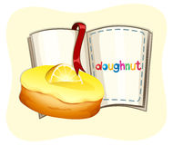 Lemon donut and a book Royalty Free Stock Images