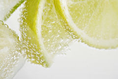 Lemon drink with bubbles Stock Images