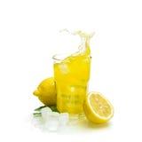 Lemon drink with ice Fruit cocktail splash Royalty Free Stock Image