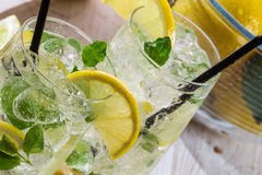 Lemon drink with ice and mint leaf Royalty Free Stock Photo