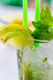 Lemon drink with lemnon, mint and ice in glass stock photography