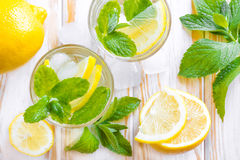 Lemon drink. With mint and ice in two glasses royalty free stock photos